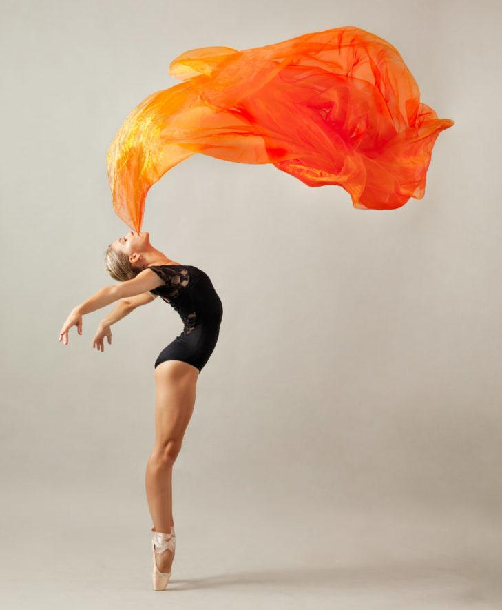 Ballerina with a fire-colored shroud.