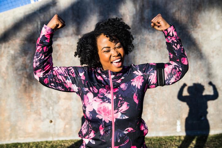 How can you be successful with your weight loss program? Incorporate exercise, adequate sleep and increased fruit and veggie intake. Image: Curvy woman celebrating during a training session.