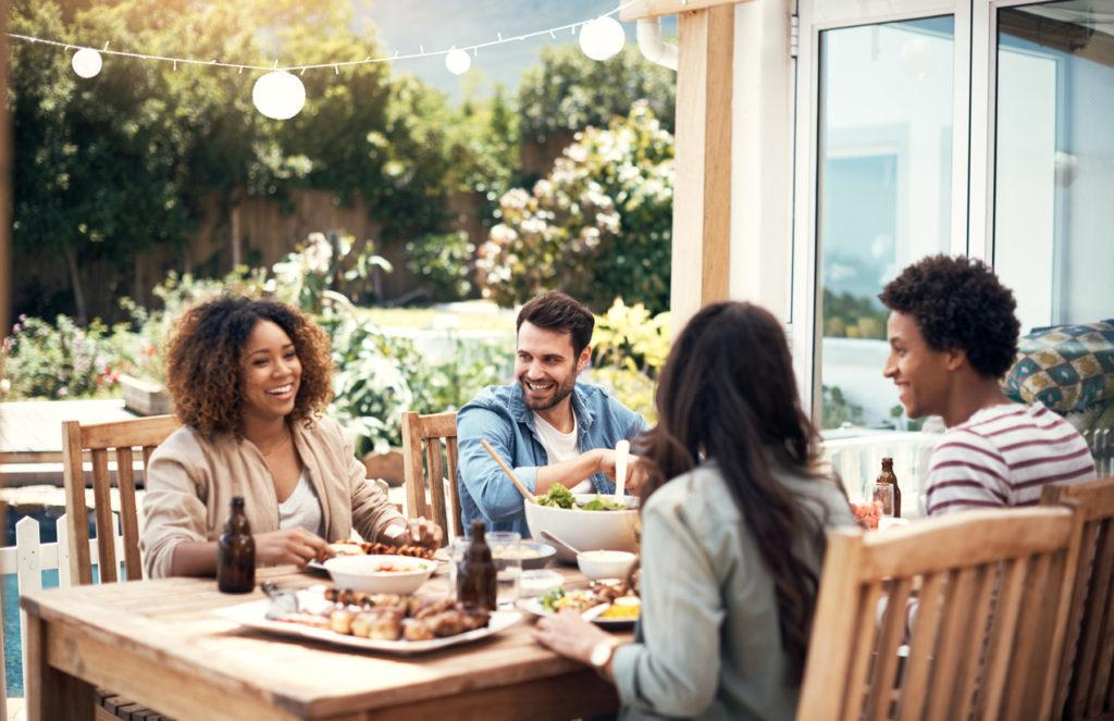 Shot of a group of friends having a meal together outdoors.