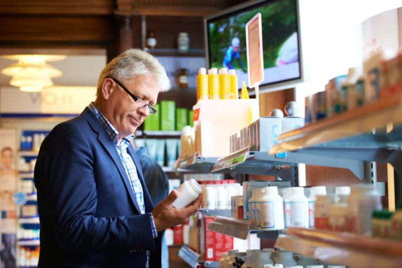 A man buying supplements in the local pharmacy.