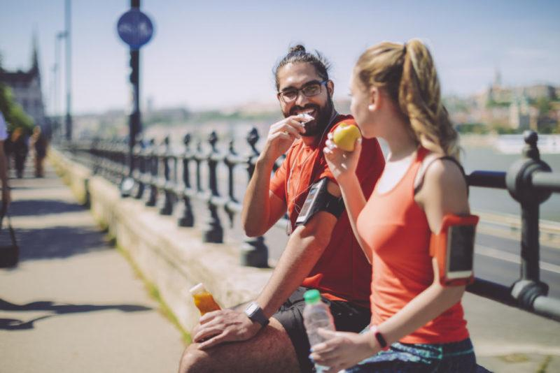 Couple having a snack after a run.