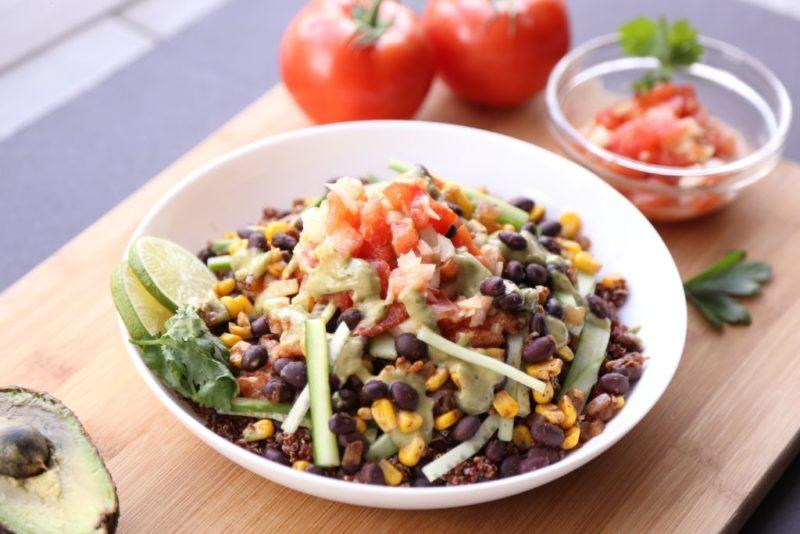 A burrito bowl with quinoa or brown rice is a fantastic plant-based, filling protein-rich meal that won't spike your blood sugar too much and that provides lots of gut healthy dietary fibers.