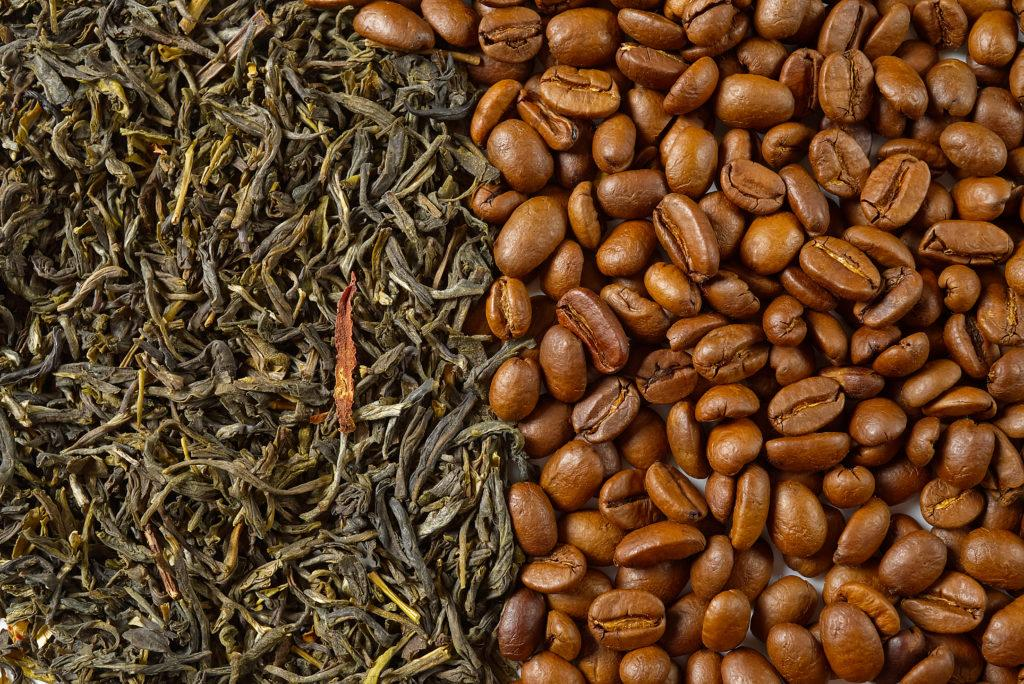 Dry leaves of green tea and fine Roasted coffee beans, top view closeup. Coffee or Green tea concept